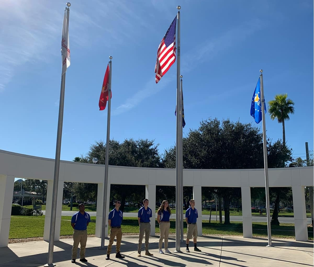 "Cadets Marcell Gilliam, Doug Nguyen, Robert Kramer, Sarah Poole, and Ryan Bowen stand among the symbols of those who have come before them."" (Photo: Embry-Riddle/Olivia Shumbo)"