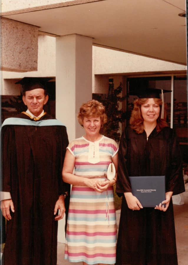 Chris Ison with dad Prof. Otis and mom Nora at graduation. Photo provided.