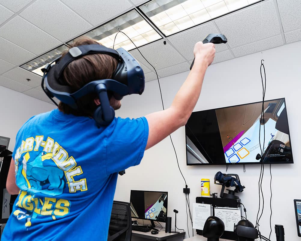 Student Alec Bischoff uses the College of Aviation's VR lab