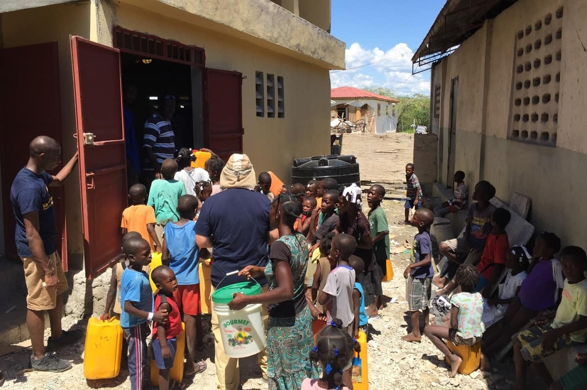 Students and faculty from Embry-RIddle talk with children in Haiti.