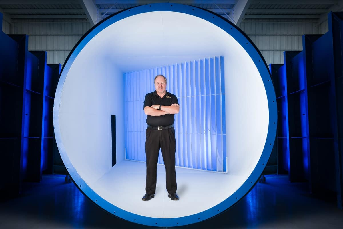 J. Gordon Leishman standing in a wind tunnel at the Embry-Riddle Research Park.