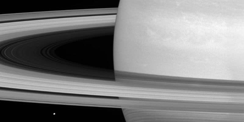 A recent photo taken by the Cassini spacecraft shows the enormity of Saturn's rings as compared to its icy moon, Mimas.