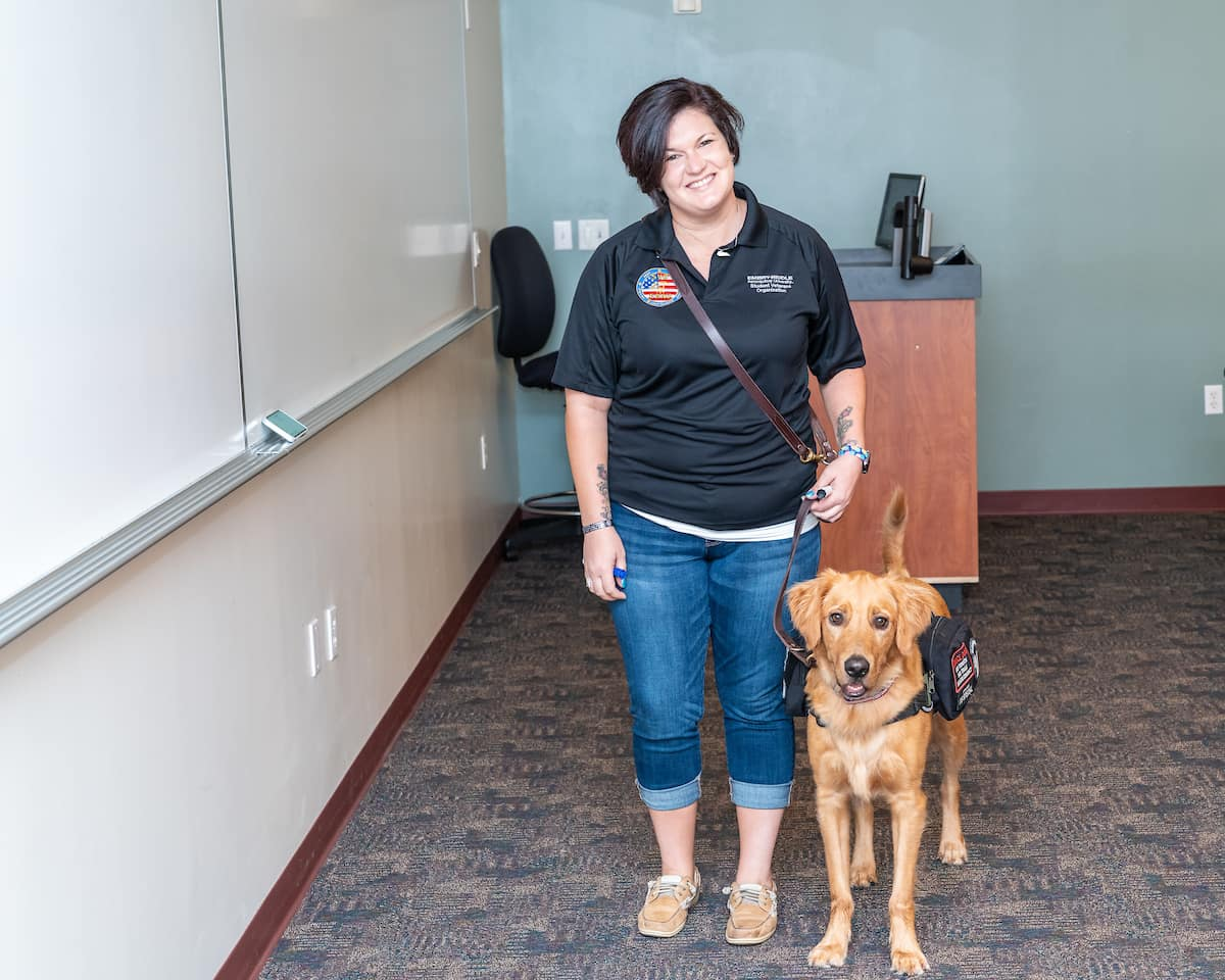 Graduate student and Army veteran Amanda Meurer helps teach new student veterans in the UNIV 101 course with her service dog, Mako, by her side.