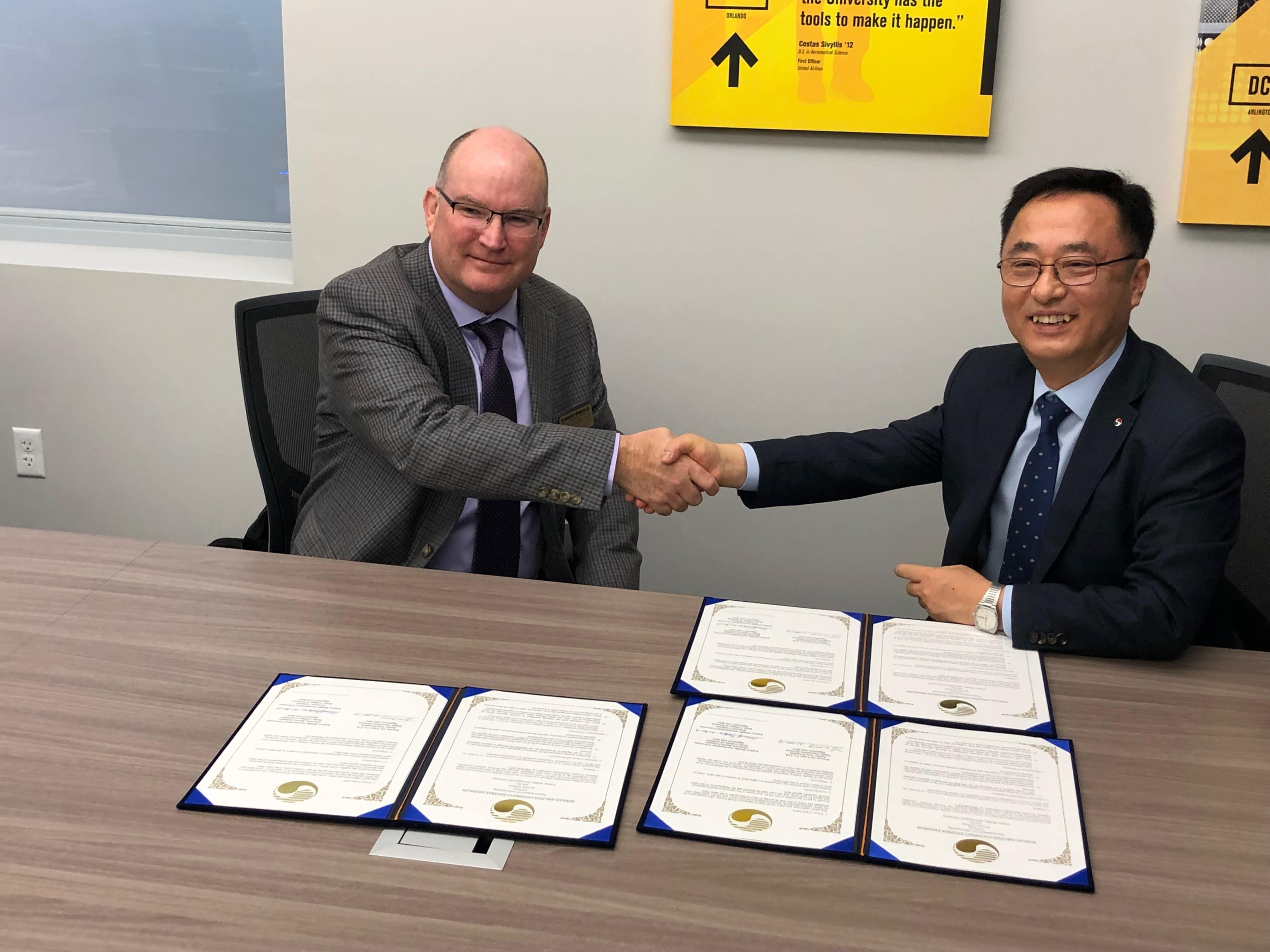 Dr. Alan Stolzer (at left), dean of the College of Aviation on Embry-Riddle's Daytona Beach Campus, recently met with Capt. Kim, senior vice president of Korean Airlines' Flight Operations division, to launch a joint career pathway program for pilots.