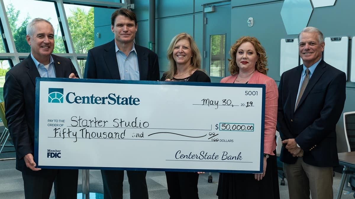 CenterStateBank officials present a check to StarterStudio to support startup businesses in central Florida. Left to right: Mike Sleaford, CenterStateBank Regional President; Embry-Riddle Senior Vice President for Administration and Planning Rodney Cruise; Executive Director Donna Mackenzie; Mellissa Slover-Athey, FVP, CRA Officer CenterStateBank; Phil Zeman, Senior Vice President, CenterStateBank. (Photo: Embry-Riddle/Daryl Labello)