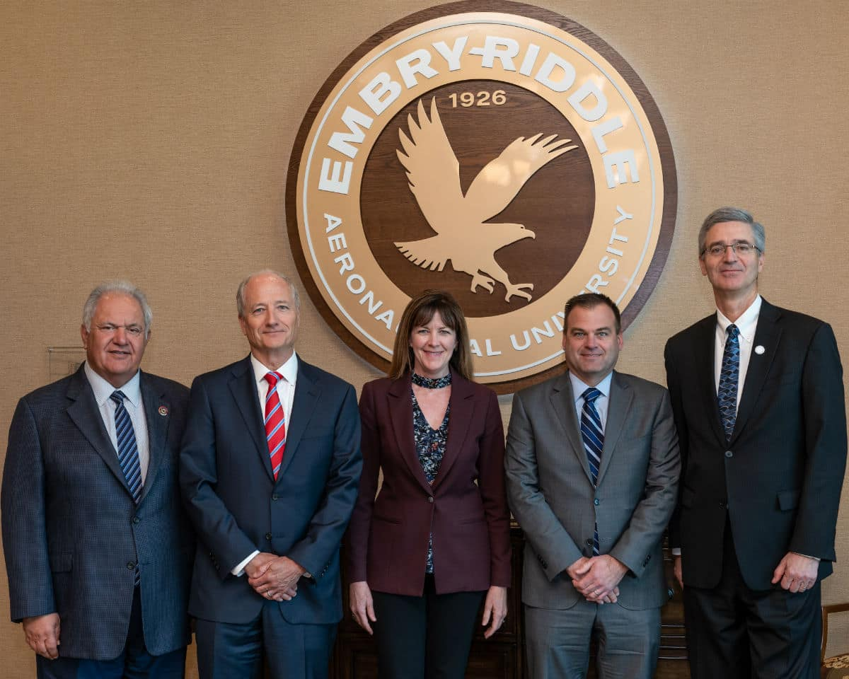 Mr. Mori Hosseini (left), Chairman of Embry-Riddle's Board of Trustees, and President P. Barry Butler (right) welcome new Trustees Neal J. Keating, Dr. Janet Kavandi and Steve Nordlund.
