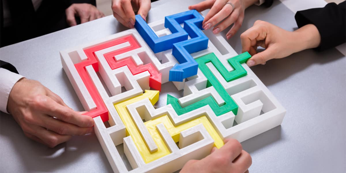 People do a maze with their hands.