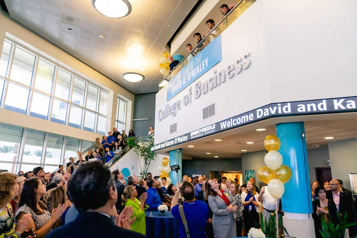 Students, faculty, and staff gather for the David B. O'Maley College of Business dedication.
