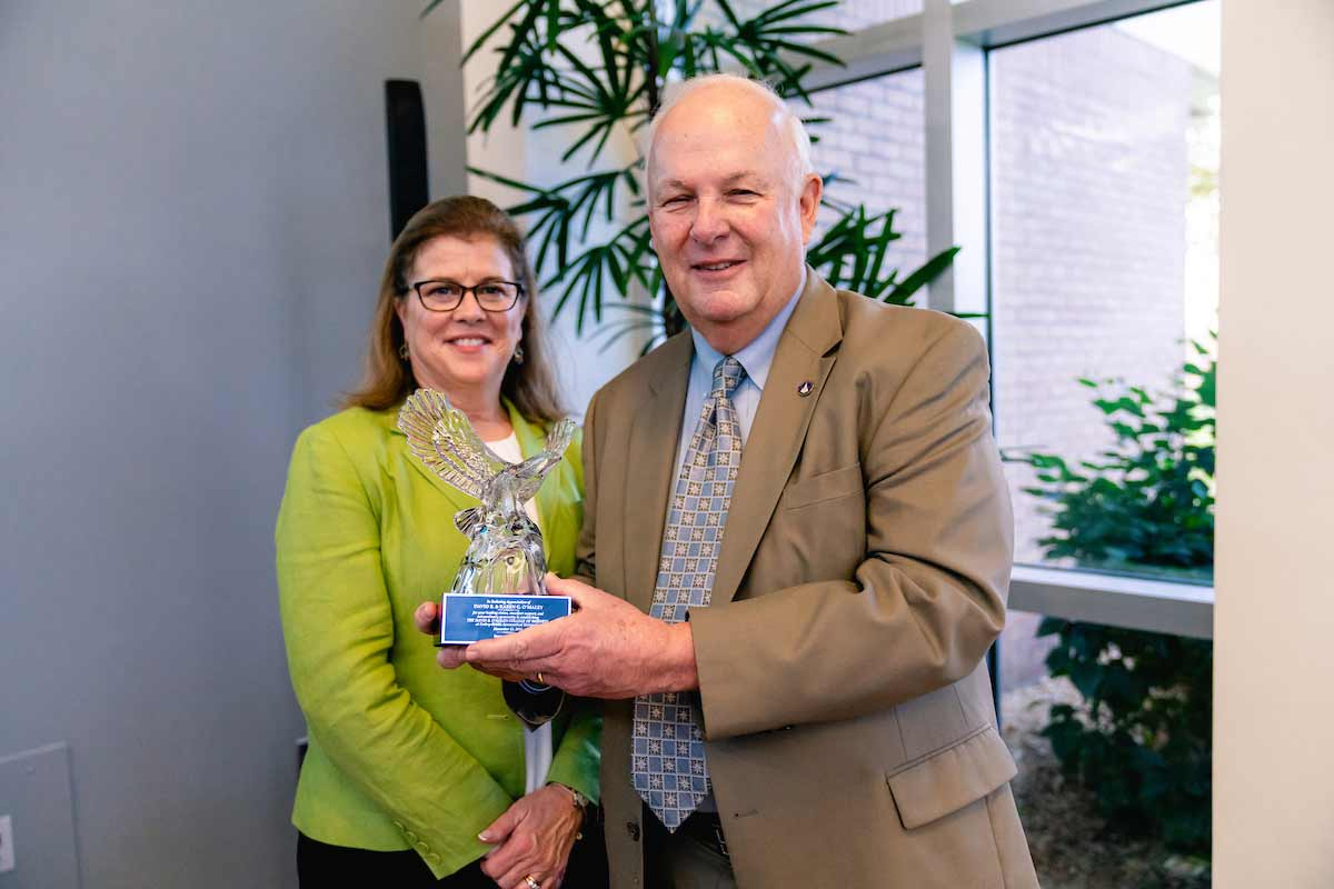 David B. Omaley and his wife karen pose with a Crystal Eagle award.