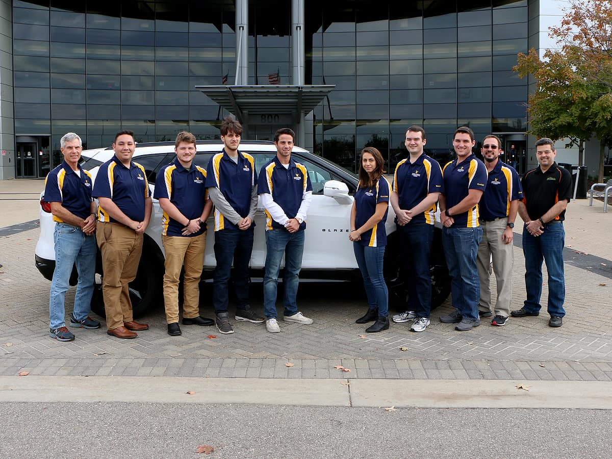 Some members of the Embry-Riddle Aeronautical University team at the EcoCAR Mobility Challenge Fall Workshop in Michigan with the 2019 Chevrolet Blazer.