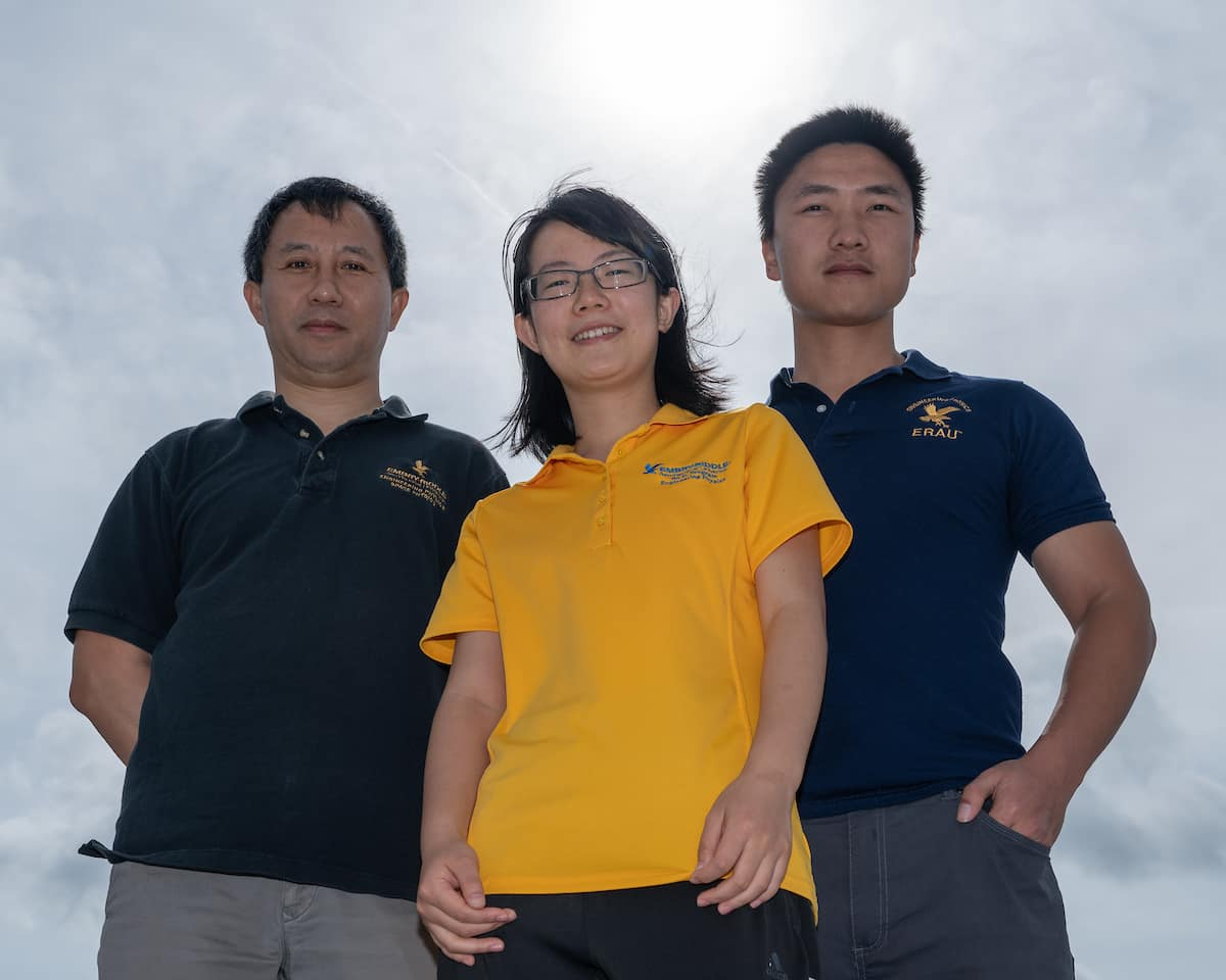Dr. Alan Liu and his students Zishun Qiao (yellow shirt) and Fan Yang (blue shirt) will use data collected during an upcoming solar eclipse to study how atmospheric gravity waves propagate upward from the troposphere, becoming large enough to cause perturbations in the mesosphere. Photo: Embry-Riddle/Daryl LaBello