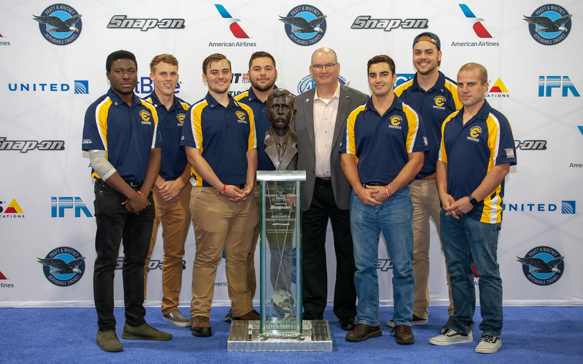 "Embry-Riddle's all-star Aviation Maintenance Team (AMS) during the recent competition in Atlanta, Ga., included (left to right) Immanuel Bankole, Christopher Lambert, Tristan Anderson, Gregory Algarin, College of Aviation Dean Dr. Alan Stolzer, Michael ""Ben"" Henriquez, Christopher Culver, and AMS staff/AMC Team manger, Christopher Piccone."