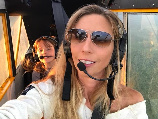 Dr. Carolina Anderson, associate professor of aeronautical science at Embry-Riddle, enjoys a flight with her daughter. Dr. Anderson's many accomplishments include being the first woman to receive a Ph.D. in Aviation.