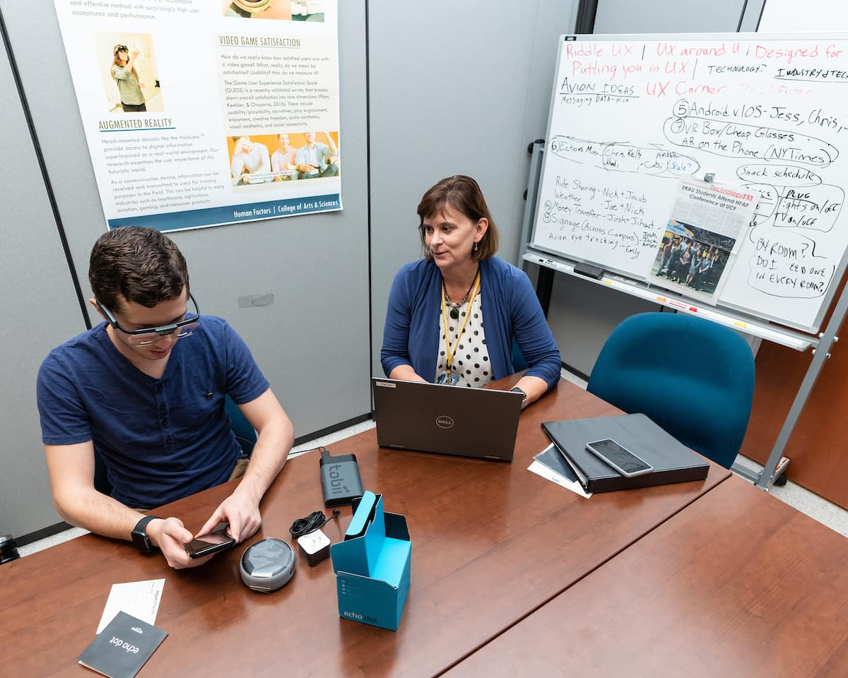 Graduate student Jacob Benedict, with Dr. Barbara Chaparro, uses Tobii Pro eye-tracking glasses as part of user experience research.