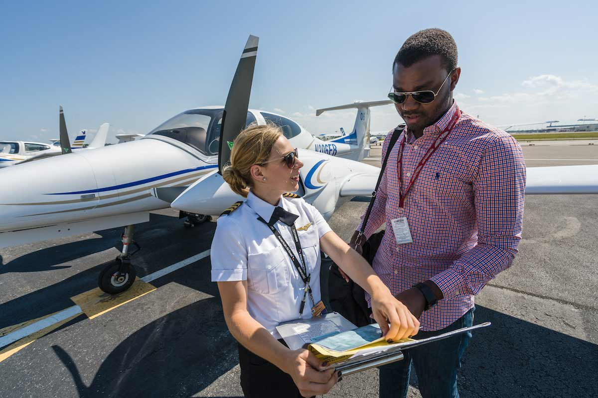 Abigail Pasmore, flight instructor, worked with flight student Eric Tetteh during a pre-flight inspection in 2016.