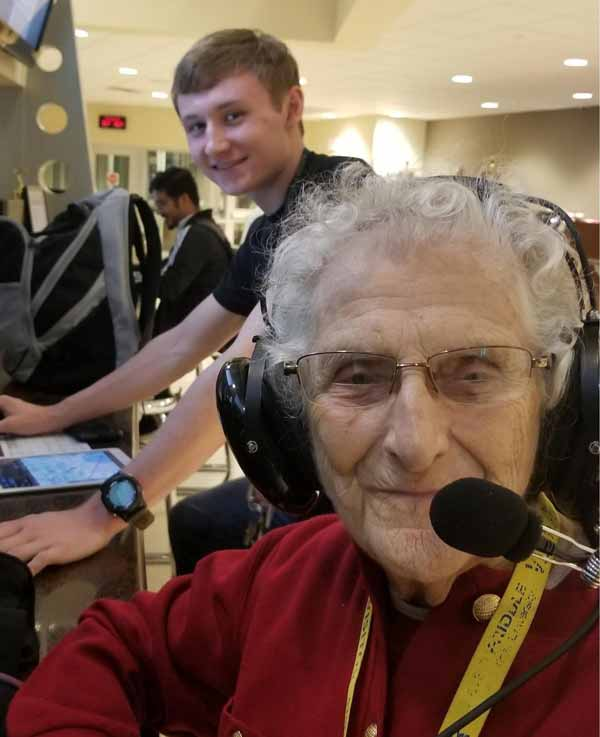 "Anna Duncan (""Grammy Cracker"") put on her headphones early as her great-grandson, Adlynn, conducted pre-flight check-in."