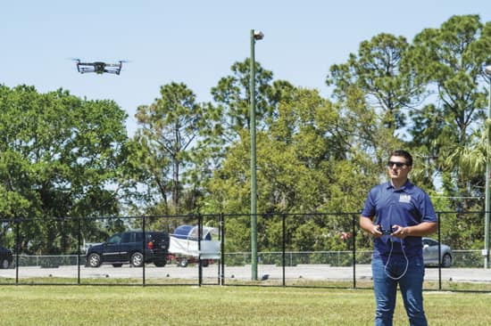 Hunter Tedrick flies a drone.