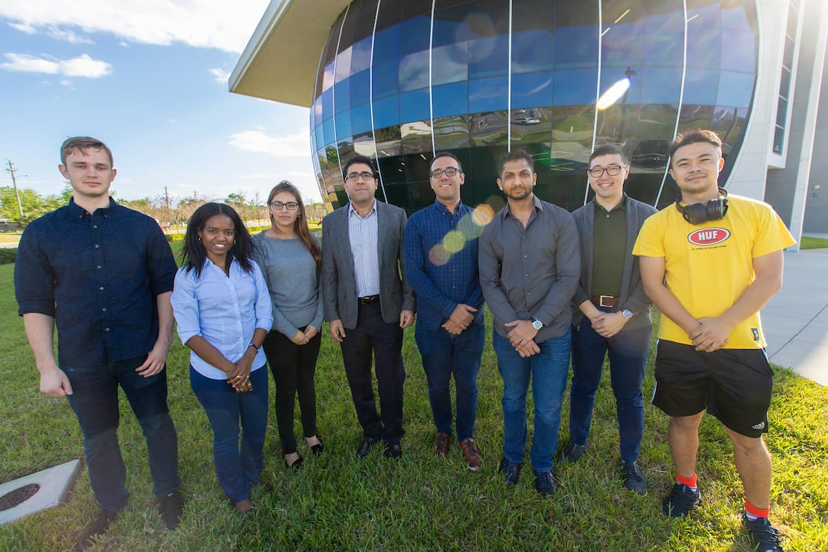 From Left: Lee Alacoque, Rossana Fernandes, Patricia Velasoc, Dr. Ali Tamijani, Dr. Kaveh Gharibi (post-doctoral researcher), Chitrang Patel and Zichao Wang, in front of Embry-Riddle's MicaPlex research facility. (Photo: Embry-Riddle/David Massey)