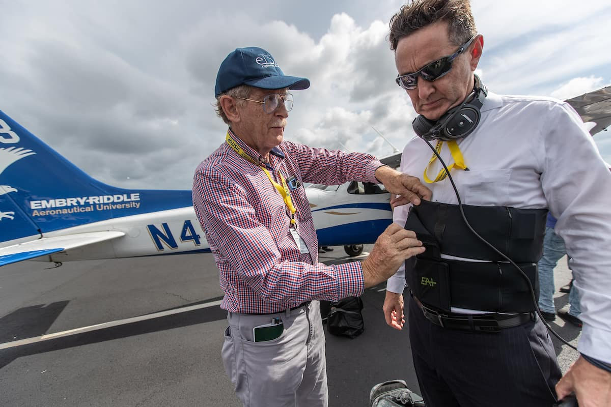 Dr. Angus Rupert, medical research scientist with the U.S. Army Aeromedical Research Laboratory, helps outfit Dr. Braden McGrath, Research Professor for Validated Mathematical Model of Spatial Disorientation, with a tactile belt that will transmit vibrations onto his torso during flight to keep him oriented, no matter what the visual conditions.