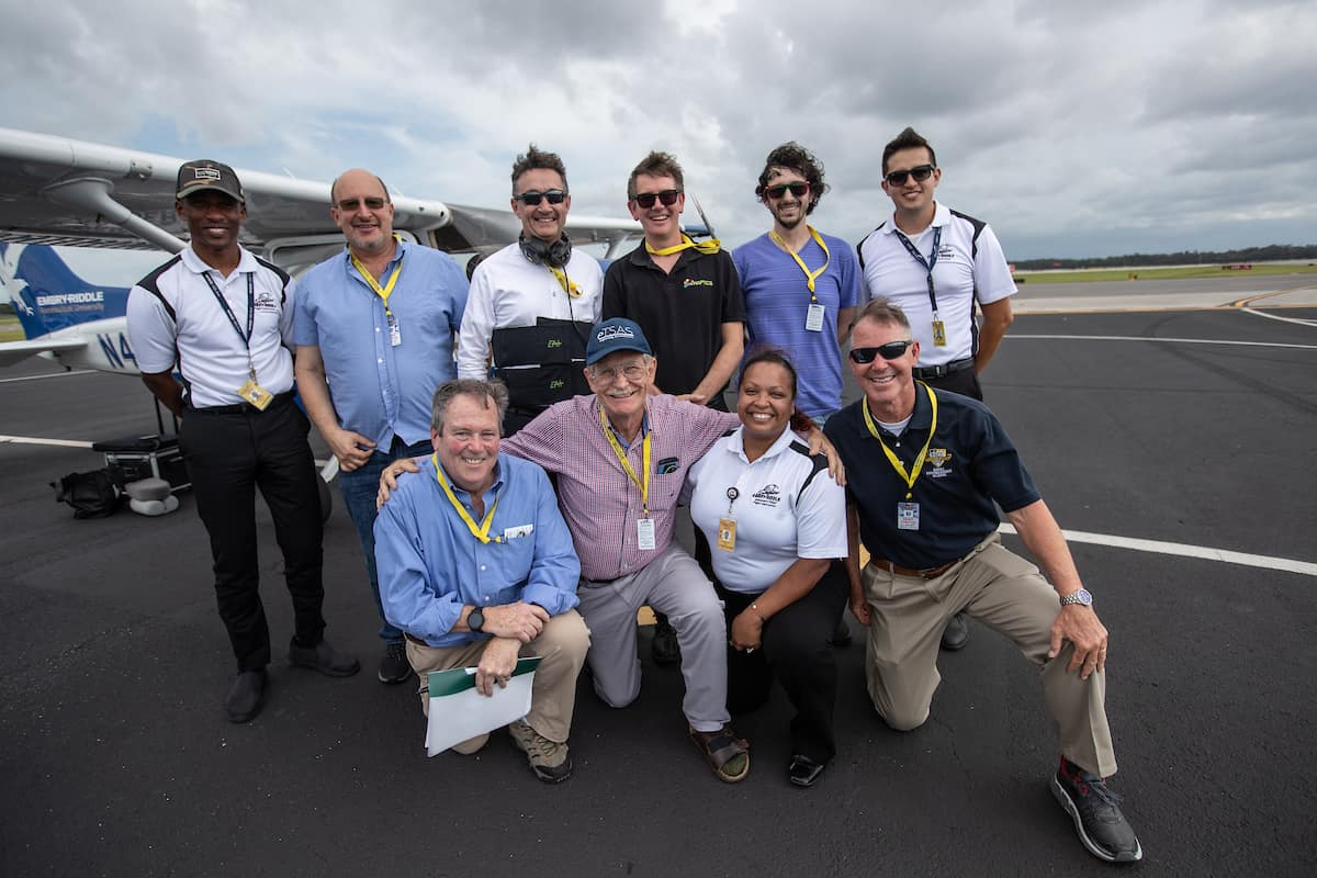 Professionals gather for a photo at Embry-Riddle Aeronautical University's Daytona Beach Campus.