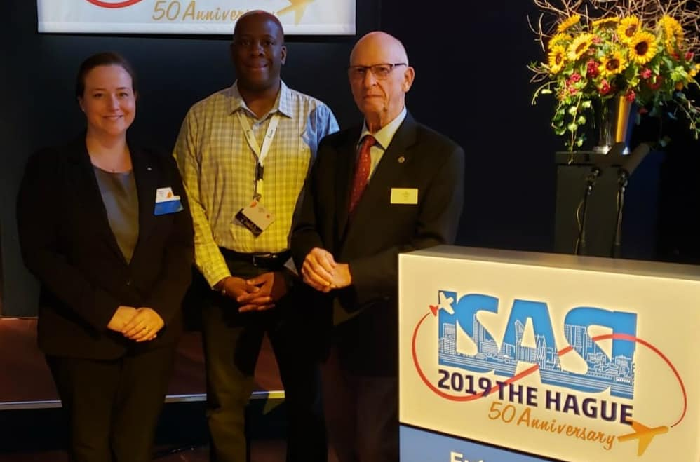 Student Stacey Jackson, Anthony Brickhouse and ISASI Treasurer/retired National Transportation Safety Board investigator Robert Macintosh