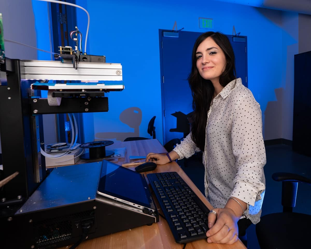 Embry-Riddle graduate student Noemi Miguelez works in the parts manufacturing section of the Wireless Devices and Electromagnetics (WiDE) Laboratory in the MicaPlex