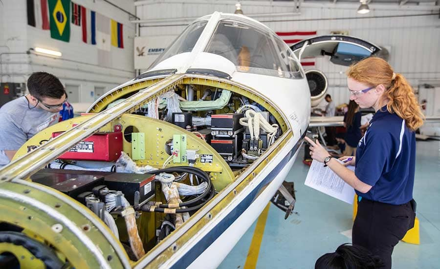 Aviation Maintenance Science students work on a Lear jet.