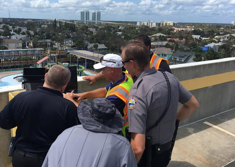 Dr. Joseph Cerreta (yellow vest) teaches police officers from the Daytona Beach Police Department, in Florida, how to conduct a post-hurricane damage assessment with a senseFly eBee after Hurricane Irma. (Photo: ERAU Assistant Professor Anthony Galante)