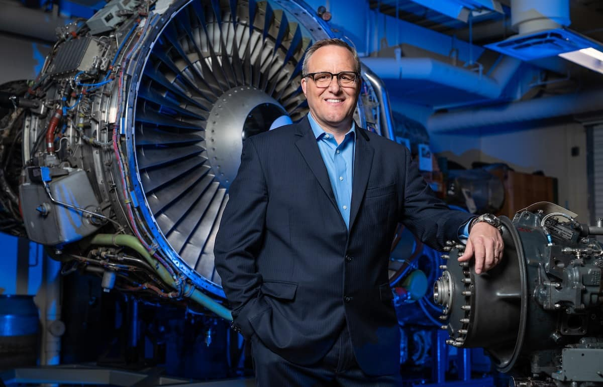 R. Eric Jones, associate professor and chair, Aviation Maintenance Science, in front of an engine