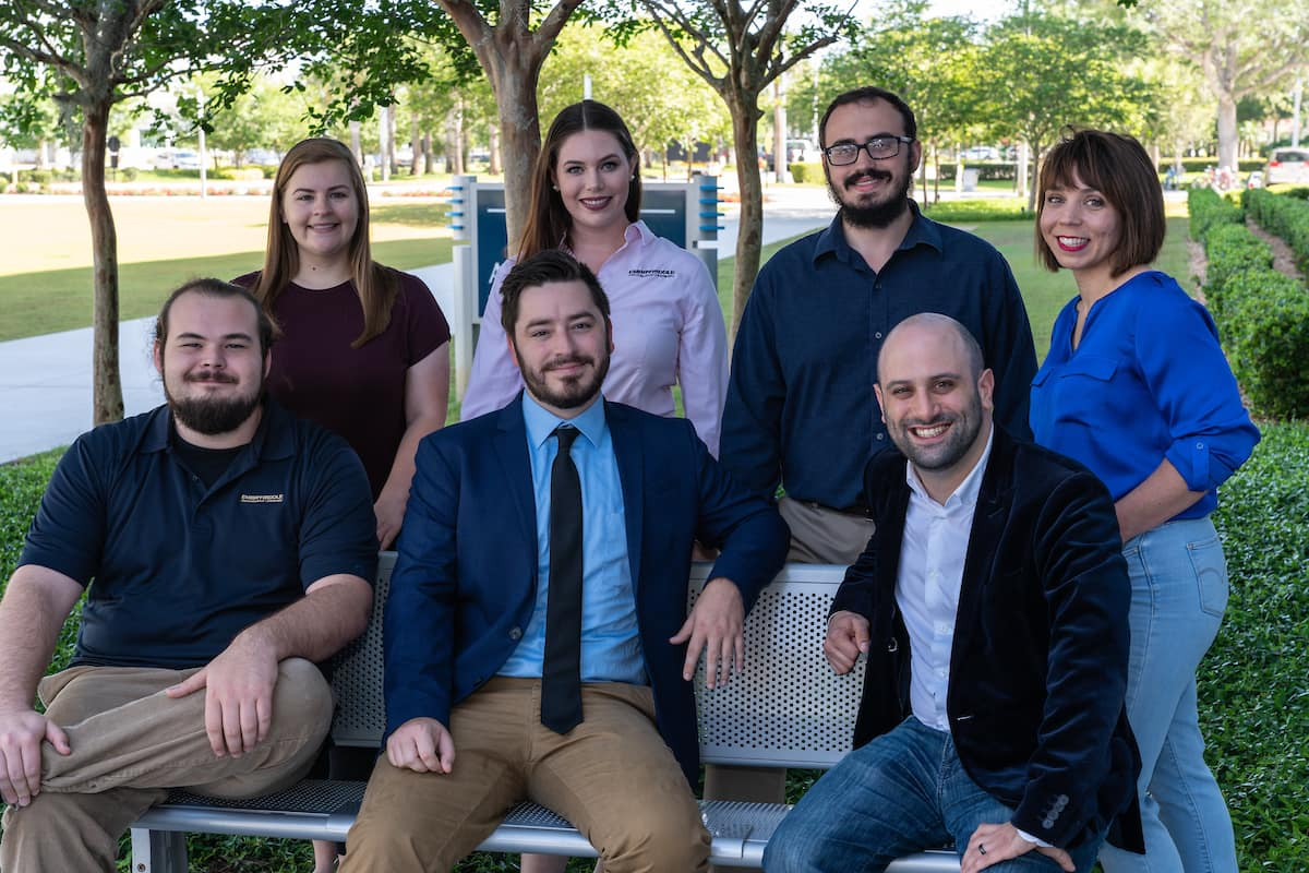 "Understanding what happens in healthcare ""handoff"" situations was the focus of research by (L-R, standing) Emily Rickel, Jordan Hilgers, Richard Simonson, Dr. Elizabeth Lazzara, and (L-R, seated) Andrew Griggs, Logan Gisick and Dr. Joe Keebler. Photo: Embry-Riddle/Daryl LaBello"