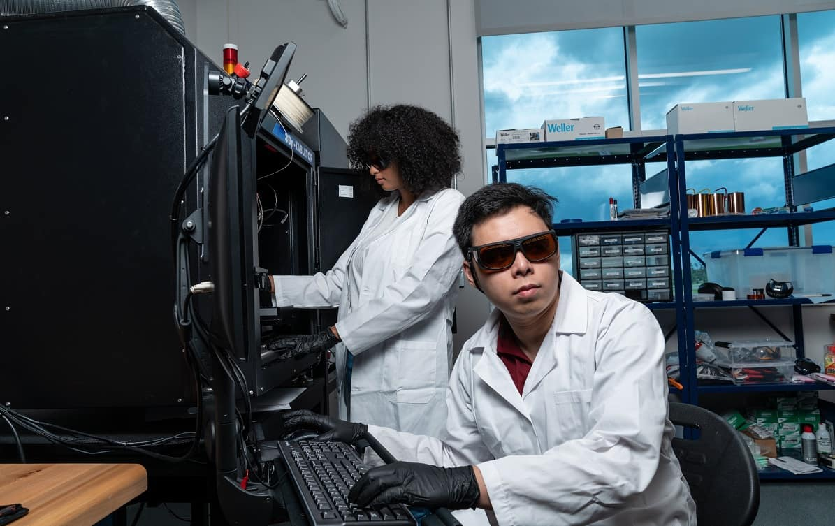 Students Sofia Mvokany and Seng Loong (Hanson) Yu use a state-of-the-art additive manufacturing system integrated with a femtosecond laser for 3D high-frequency electronics in Embry-Riddle's new Wireless Devices and Electromagnetics (WiDE) Laboratory.