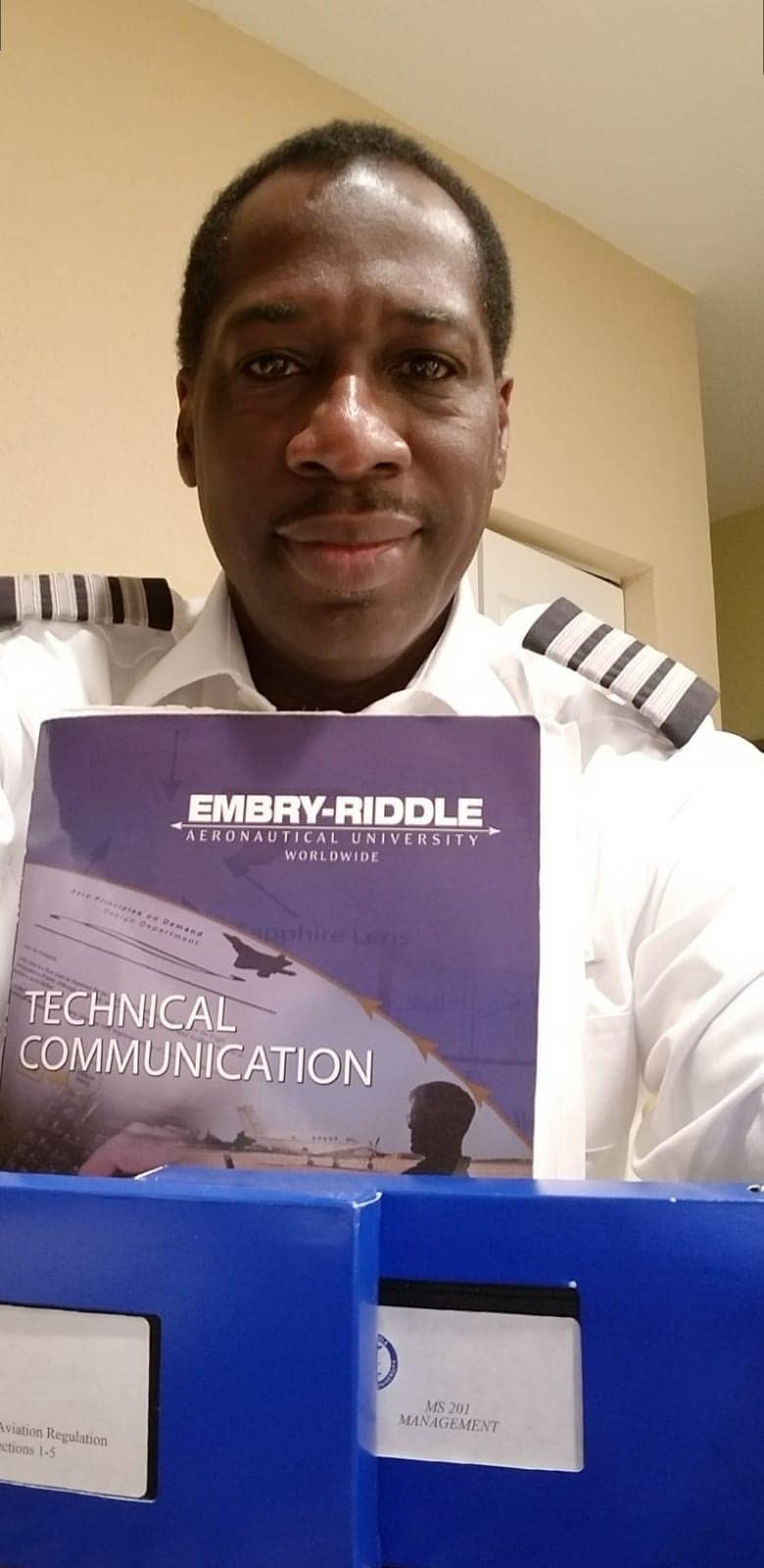pilot Garfield McFarlane holds an embry-riddle pamphlet