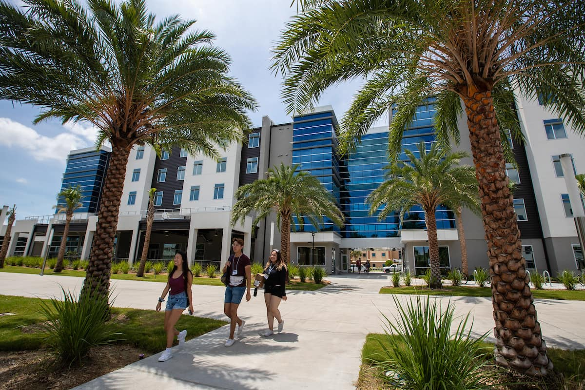 Students walk in front of the New Residence Hall 2