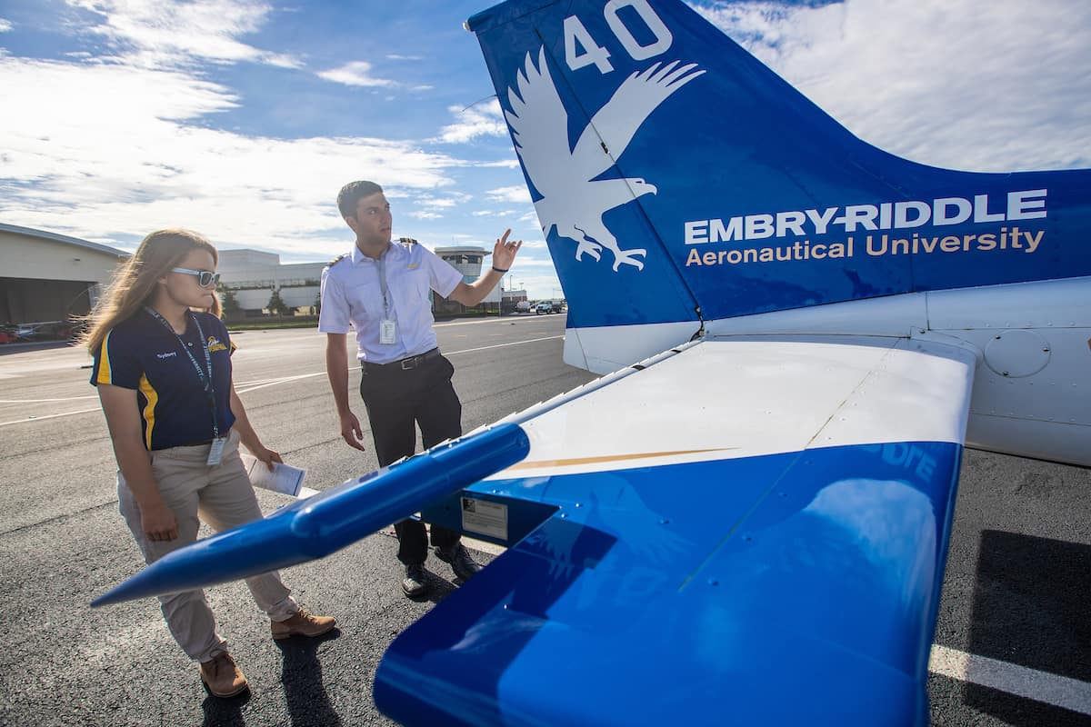 Embry-Riddle students Tyler Rispoli, a flight instructor, and Sydney Pilling complete a pre-flight inspection on an aircraft. Both are members of the Eagles Flight Team
