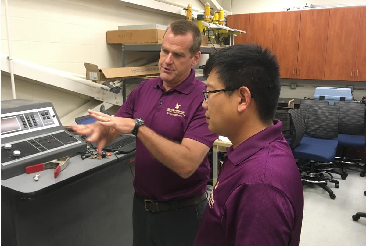 Associate professor of Civil Engineering Jeff Brown and assistant professor Dan Su discuss the testing of a reinforced concrete beam using distributed optical fiber sensors.