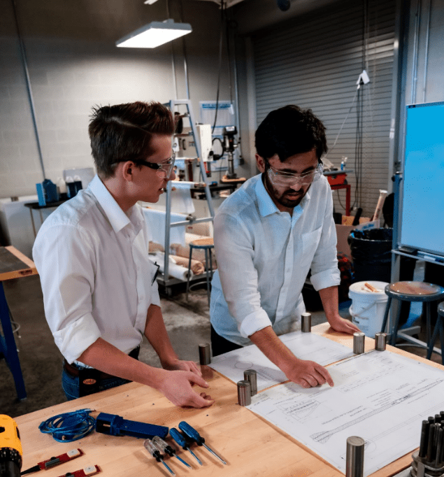 Aerospace Engineering/Astro-track students Cooper Eastwood (freshman) and Gaurav Nene (sophomore) work on their Suborbital Reusable Vehicle (SRV) research project in a lab at Embry-Riddle's Prescott Campus. (Photo: Gaurav Nene)