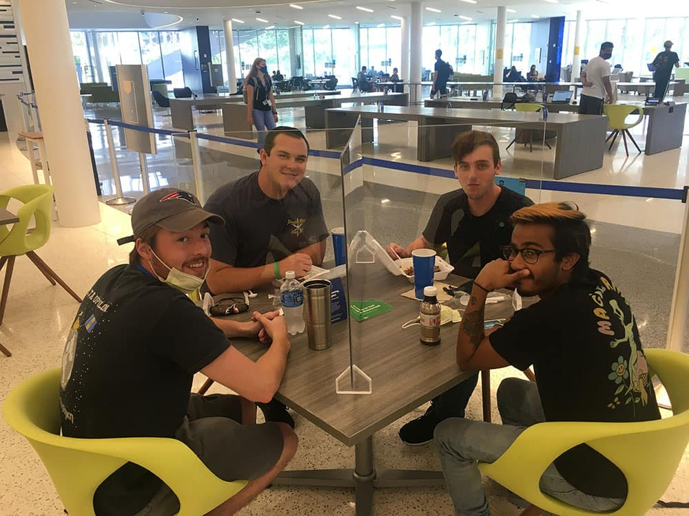 New Plexiglas barriers let Embry-Riddle students briefly remove their required face coverings to share food, fun and fellowship.