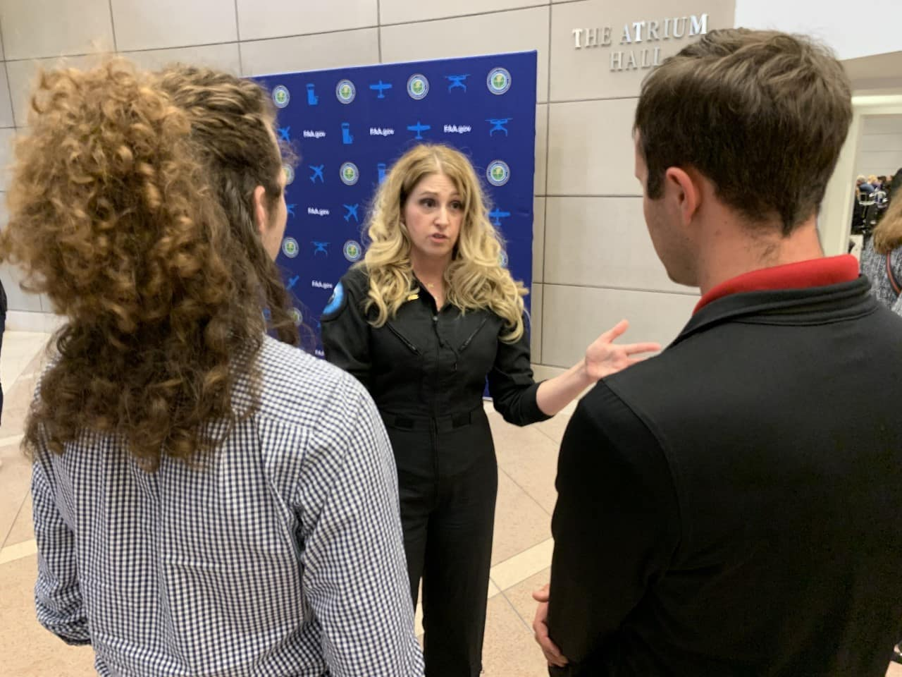 Embry-Riddle students Max Cannon and Noah Eudy meet Virgin Galactic Chief Astronaut Instructor Beth Moses at the 2020 Commercial Space Transportation Conference held in January in Washington, D.C.