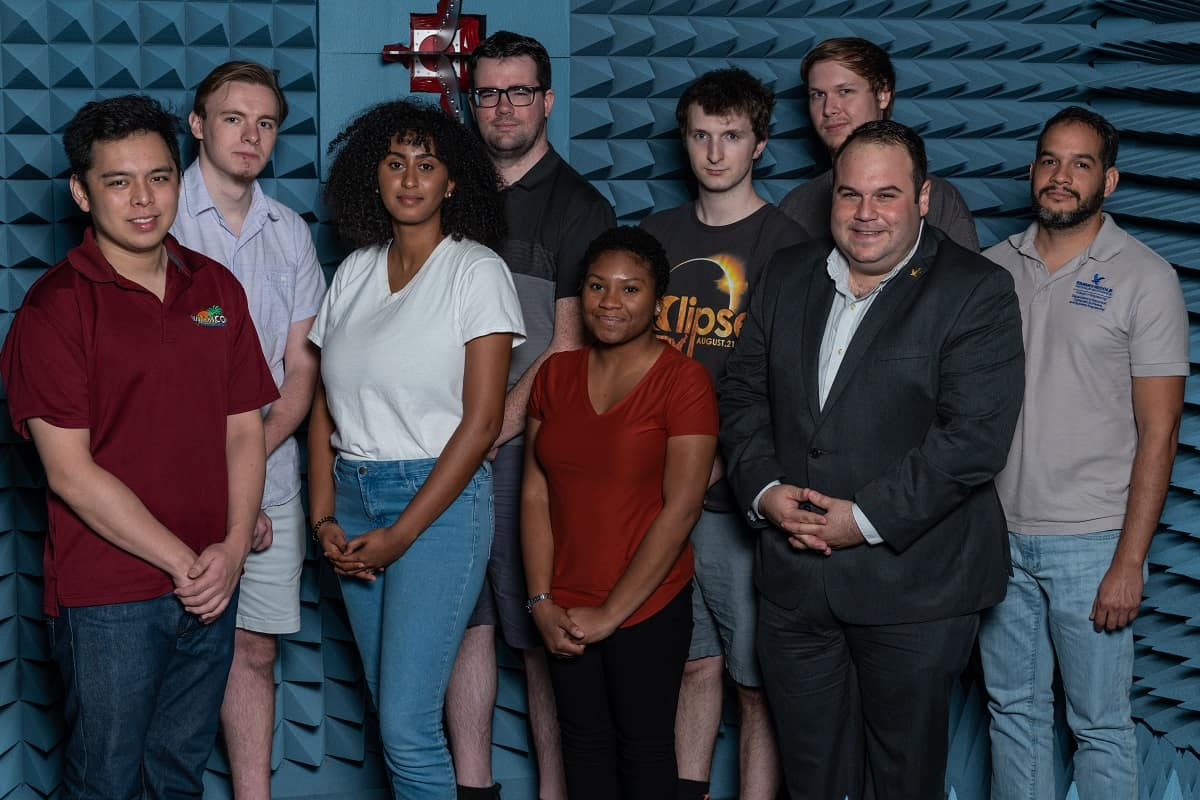 NSF Early Career Award Winner Dr. Eduardo Rojas (second from right) and his students are shown in the anechoic testing chamber in Embry-Riddle's Wireless Devices and Electromagnetics (WiDE) Laboratory, which is part of the MicaPlex research facility. (Photo: Embry-Riddle/Daryl LaBello.)