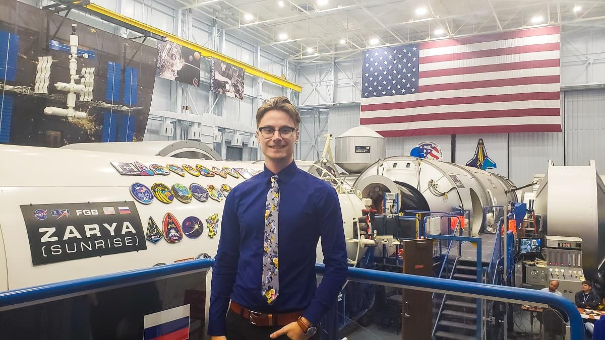 Spaceflight Operations senior Nicholas Lopac stands in the Vehicle Mockup Building, where astronauts train for new vehicles and the International Space Station, during a recent internship at NASA