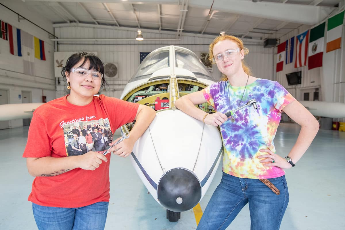 Aviation Maintenance Science students Roxanne Rosado and Sarah Fairchild work on the Lear Jet at Embry-Riddle's Daytona Beach Campus in 2019. (Photo: Embry-Riddle/David Massey)