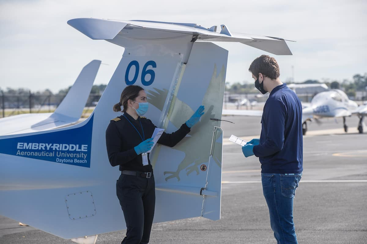 Flight Instructor Anna Battison performs a pre-flight check with student pilot Dawson Schriner at Embry-Riddle Aeronautical University's Daytona Beach Campus Flight Line.