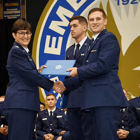 Col. Kimberley Ramos, left, at the AFROTC Commissioning Ceremony in May. Second Lt. Brandon Koury received distinguished graduate recognition.​
