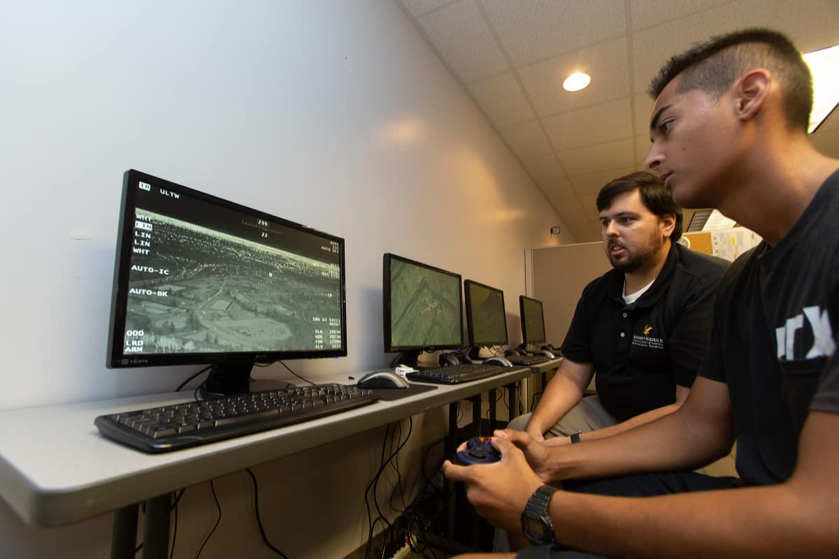 UAS Simulation and Flight instructor Billy Rose works with lab assistant, Justin Krupinski on the new Meta VR platform in the UAS Sim Lab, at Embry-Riddle's Daytona Beach Campus.